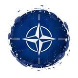 Rund grungeflagga av Nato med färgstänk i flaggafärg royaltyfri illustrationer