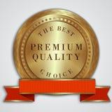Rund guld- emblemetikett för vektor med det röda bandet Arkivfoton
