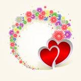 Rund krans av blommor och två hjärtor Arkivfoto