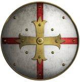 Rund medeltida sköld med det guld- korset Arkivfoto