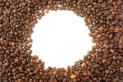 Rund ram av kaffebönor Arkivfoto