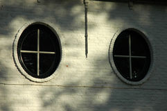 runda fönster Arkivfoto