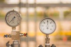 Runda industriella tryckmätare för gas Fotografering för Bildbyråer
