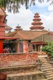 Runda mång--tiered torn i den nasala Chowk borggården av Hanuman Dhoka Durbar Square, Katmandu Arkivbild