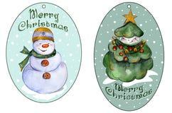 Rundade xmas-etiketter för gåvor med att le julgranen och snögubben Arkivbilder