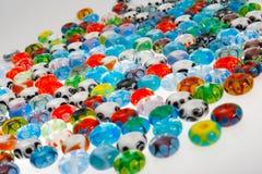 Rundaexponeringsglas pryder med pärlor Arkivfoto