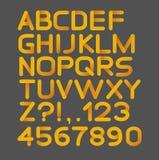 Rundat pappers- gult strikt alfabet Isolerat på svart fetare Fotografering för Bildbyråer