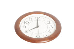 Runde Bürouhr, die acht O-` Uhr lokalisiert auf Weiß zeigt Stockfoto