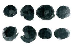 Runde Formen der schwarzen Tinte lokalisiert auf Weiß Lizenzfreies Stockfoto