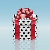 Runde Geschenkbox mit rotem Band Stockfotos