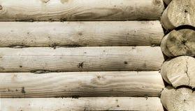 Runde hölzerne Klotz des Hausmauerbildes Lizenzfreie Stockbilder