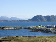 Runde, Norway. Fishing boat passing Runde, and island on the west coast of Norway Stock Images