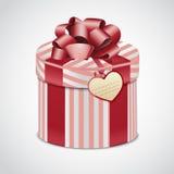 Runde rosa Geschenkbox mit Streifen Stockfoto