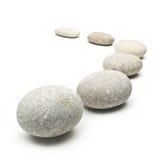 Runde Steine lokalisiert auf Weiß Lizenzfreies Stockfoto