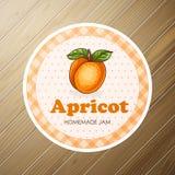 Runder Aufkleber, Aprikosenmarmelade auf einem hölzernen Hintergrund Lizenzfreie Stockbilder