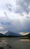 Rundle and Clouds. Mount Rundle and clouds reflecting in the Vermilion lakes.  Located in Banff National Park, Alberta, Canada Stock Image