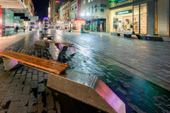 Rundle Mall at night time. Adelaide, Australia - August 11, 2015: Adelaide's famous Rundle Mall at night time under the rain during winter season Royalty Free Stock Images