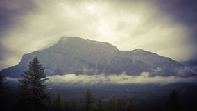 Rundlestone mountain banff. Mountain forest national park Canada Alberta Banff trees peak clouds morning Stock Photos