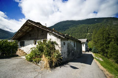 Rundown building in mountains stock photography