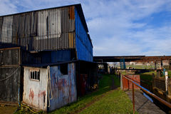 Rundown corrugated steel buildings. Royalty Free Stock Photo