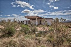 Rundown gas station now a ghost town in the AZ Desert stock photo