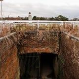 Rundown horse track tunnel stock photo