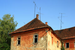 Rundown House. An old house with antennas on the roof Stock Photos
