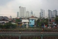 Rundown houses along Jakarta-Serpong railway. Rundown houses along Jakarta-Serpong railroad, Indonesia Royalty Free Stock Image