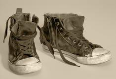 Rundown sneakers. Pair of rundown sneakers in warm toned ambiance Stock Photo