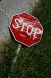 Rundown stop sign. A beat up stop sign on the side of a road stock image