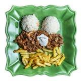Rundvlees Stroganov/Beef stroganoff met gebraden gerechten Royalty-vrije Stock Foto