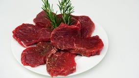 Rundvleeslapjes vlees met rozemarijn Royalty-vrije Stock Afbeeldingen