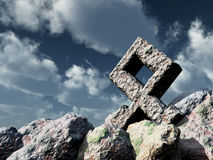 Rune rock under cloudy blue sky Royalty Free Stock Images