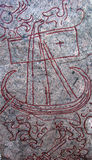 Rune stone. A detail a swedish rune stone with a carving of a viking boat. (sparlösastenen Stock Image