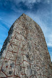 Rune stone and a dramatic sky Stock Photos