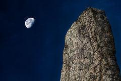 Rune stone and moon. Rune stone, moon and dark blue sky during blue hour Stock Photo