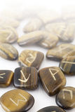 Rune Stones carved in Tiger's Eye Royalty Free Stock Images