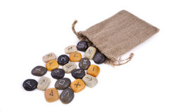 Rune Stones on white background. With a jute bag Royalty Free Stock Photos
