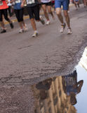 Runers. Running a marathon after the rain Stock Photography