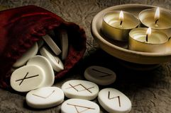Runes. Stony runes with three candles in old coloring style Stock Images