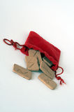 Runes. Clay runes falling out of red bag Royalty Free Stock Photography