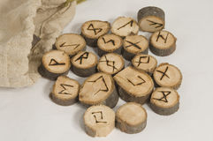 Runes. Ancient wooden runes for telling the future made of sticks cut in slices and symbols burnt in the wood Stock Photos