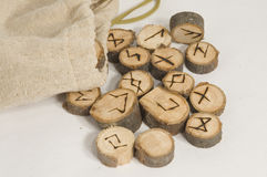Runes. Ancient wooden runes for telling the future made of sticks cut in slices and symbols burnt in the wood Stock Images