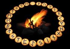 Runes around fire on black background