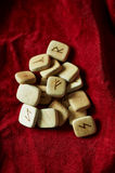 Runes on a background of rough suede mint Stock Images