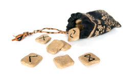 Runes and bag. Runes and a velvet bag isolated on white Royalty Free Stock Photography