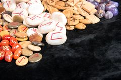 Runes of different materials. Scattered magic runes made of different materials closeup Stock Photo