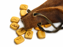 Runes in leather sack. Wooden old  runes in rough leather sack Stock Photography