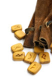 Runes in leather sack. Wooden old  runes in rough leather sack Royalty Free Stock Photo