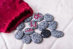 Runes of natural stones  on velvet bag Stock Photography